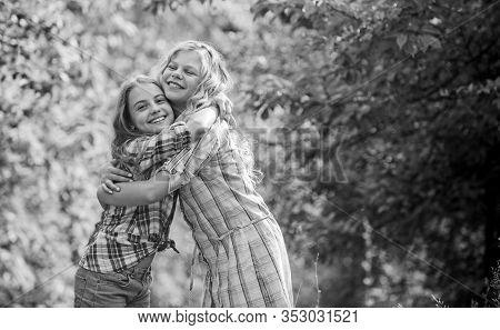 Girls Children Best Friends Hug. Sisterhood Love And Support. Happy Childhood. Hug And Love Concept.