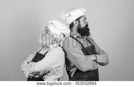 Culinary Industry. Chef Men Wear Aprons. Father And Son Culinary Hobby. Cafe Workers. Culinary Show.