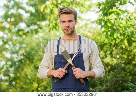 Barbeque Party. Picnic Concept. Bbq Chef. Handsome Guy Cooking Food. Cooking Burgers. Man Hold Barbe