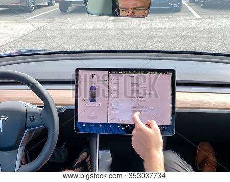 Orlando, Fl/usa-2/17/20:  A Tesla Model 3 Customer Getting Ready To Take A Test Drive With A Tesla E