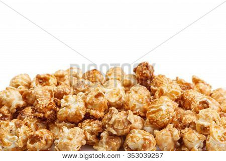 Heap Of Delicious Caramel Popcorn, Isolated On White Background. Scattered Popcorn Texture Backgroun