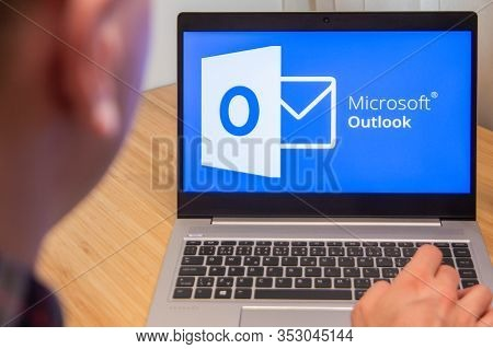 Outlook Is Used By A Man On The Laptop. Microsoft Customer Used Computer Software. New Product Is Te