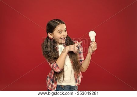 Fresh Ideas. Electricity And Energy. Little Girl Hold Light Bulb. Cute Child Search For Inspiration.