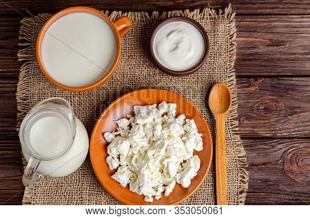 Homemade Fermented Milk Products Kefir, Cottage Cheese, Sour Cream On A Wooden Background, Copy Spac