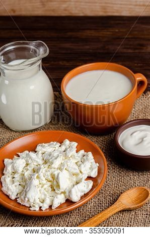 Homemade Fermented Milk Products Kefir, Cottage Cheese, Sour Cream On A Wooden Background. Healthy E