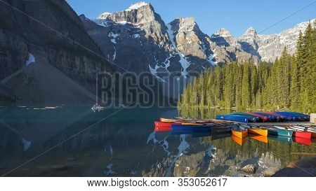 Tourists Paddling A Canoe On Moraine Lake In Banff Np, Canada