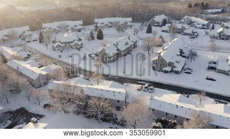Aerial View Of Residential Houses, Condo, Townhouses Covered Snow At Winter Season. Establishing Sho
