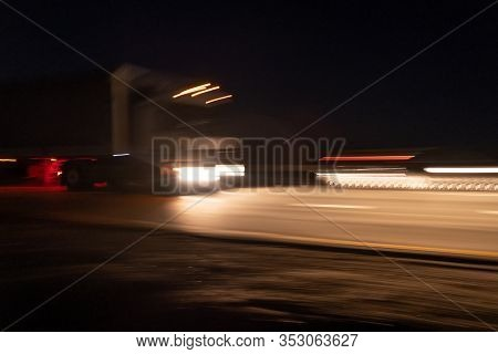 The Cars Moves At Fast Speed At The Night. Blurred Lights With Car On High Speed. Selective Focus.