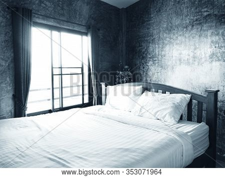 Generic Bedroom Interior Of Double Bed With Sun Light Through Window, Monotone Color.