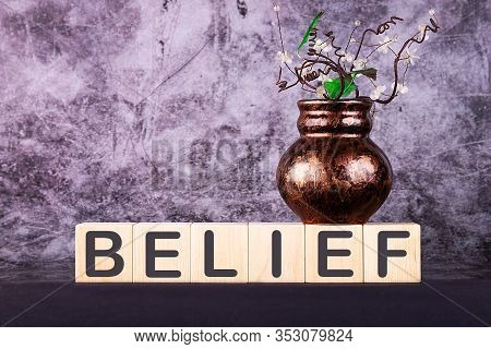 Word Belief Made With Wood Building Blocks On A Gray Back Ground