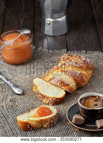 Freshly Baked Sweet Braided Bread, Coffee And Jam, Concept Holliday Breakfast. Close Up, Shallow Dep