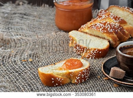 Sliced Sweet Braided Bread, Coffee And Jam. Concept Holliday Breakfast. Closeup, Shallow Depth Of Fi