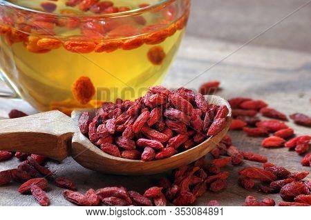 Goji Berries In A Wooden Spoon. Goji Berry Tea.