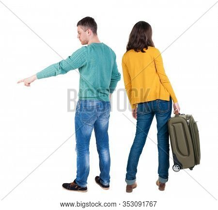Back view couple in sweater traveling with suitcas. Rear view people collection. backside view of person. Isolated over white background.