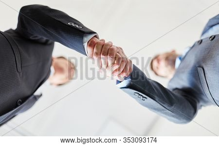Two successful business people make a business handshake