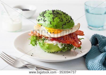 keto paleo diet avocado breakfast burger with bacon, egg, tomato