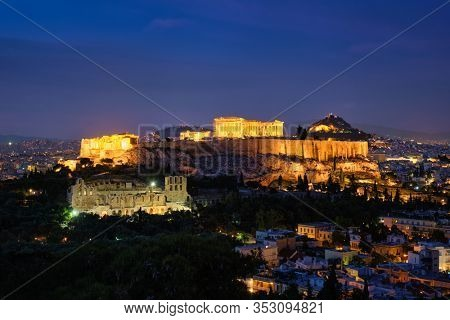 Famous greek tourist landmark - the iconic Parthenon Temple at the Acropolis of Athens as seen from Philopappos Hill in the evening blue hour, Athens, Greece