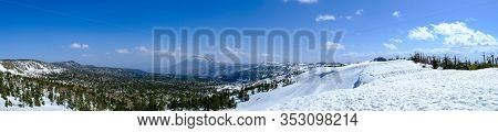 Panorama View Of Mount Hachimantai, With Green Pine Forest And White Snow Foreground With Blue Sky I