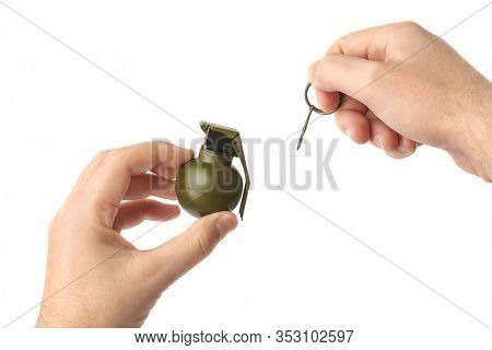 Hand pulls a check from a grenade isolated on white background