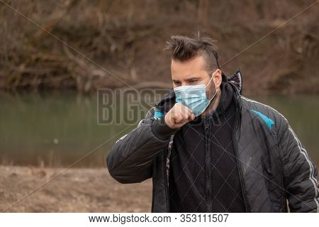 Man With Medical Mask Coughing. Mask To Protect Him From Virus .man With Mask For Coronavis. People