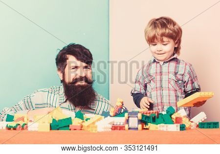 Family Fun. Building Home With Colorful Constructor. Happy Family Leisure. Father And Son Play Game.