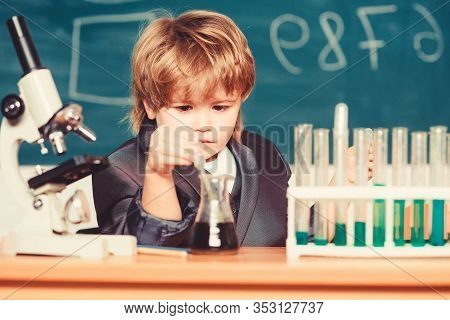Education Concept. Wunderkind Experimenting With Chemistry. Boy Test Tubes Liquids Chemistry. Chemic