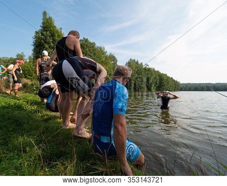 Sports People Are Preparing For Race Start In Pond. Amateur Samuel Xc Triathlon Radvanec, Czech Repu