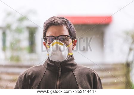 Flue And Corona Safety Concept. Man Wearing Face Mask To Protect Himself, Outdoors