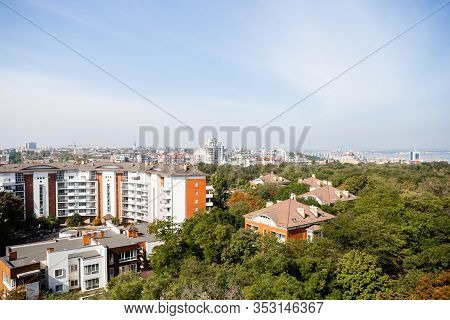 Top View Of City Scape Odessa, Ukraine Summertime. Aerial View Of Green Trees And Modern Buildings.