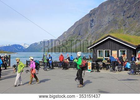 Jotunheimen, Norway - August 1, 2015: People Prepare To Hike Besseggen Trail In Gjendebu, Jotunheime