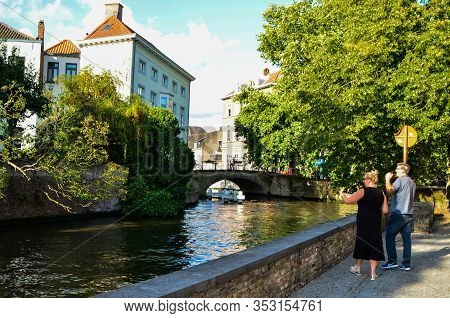 Bruges, Belgium. August 2019. One Of The Ancient Stone Bridges: They Characterize The Place With The