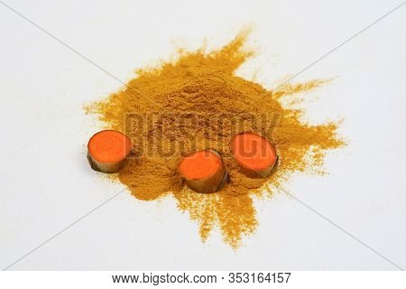 Turmeric Root And Turmeric Powder (turmeric) Isolated On A White Background As An Ingredient In Turm