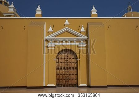Bright Yellow Colonial Style Cathedral In The Plaza De Armas Of Trujillo, Peru