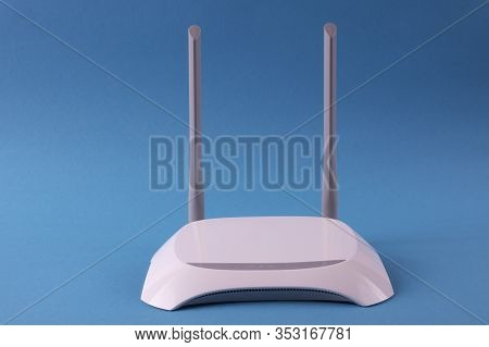White Wi-fi Router On A Blue Background.