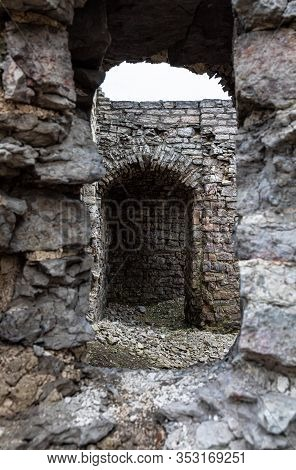 View To The Old Or Ancient Wall Ruines Of The Stone Castle Or Fortress Through Embrasure Or Loophole