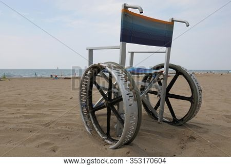 Special Wheelchair With Big Wheels On The Beach Without People In Summer