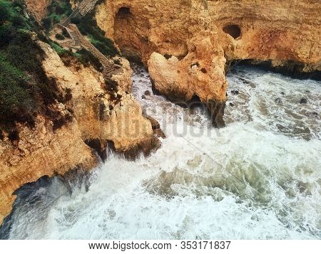 Aerial Above View Of Ponta Da Piedade Headland With Group Of Rock Formations Yellow-golden Cliffs Al