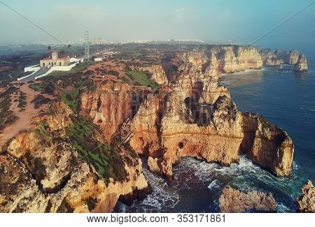 Aerial Panoramic Photo Above View Of Ponta Da Piedade Headland With Group Of Rock Formations Yellow-