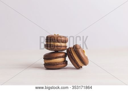 Tasty French Macarons On A White Background. Chocolate Macarons With Peanuts. Place For Text.