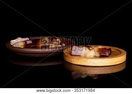 Lot Of Whole Sweet Jelly Cola With Brown Ceramic Coaster On Round Bamboo Coaster Isolated On Black G