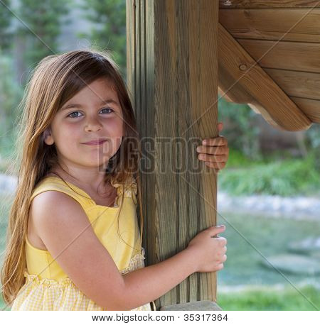 Young Girl Leaning On A Post