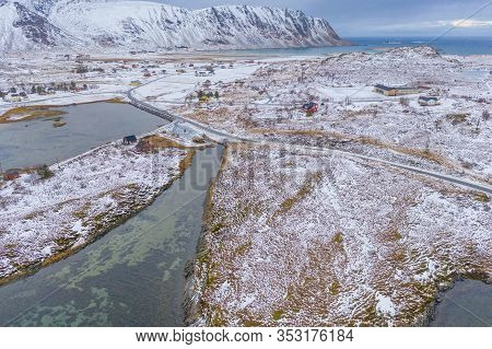 Aerial View Of White Snow Mountain In Lofoten Islands, Nordland County, Norway, Europe. Hills And Tr