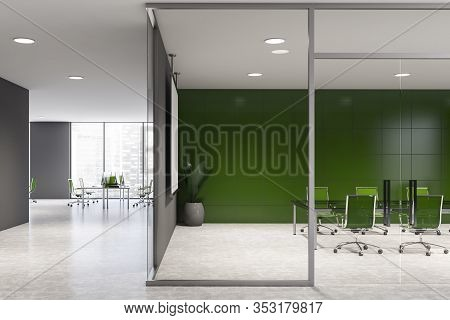 Bright Conference Room With Green Tiled Walls, Concrete Floor And Long Meeting Table With Green Chai
