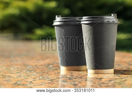 Paper Coffee Cups On Stone Parapet Outdoors, Closeup