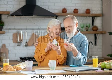 Elderly Married Couple Reading Instruction For Using Supplement
