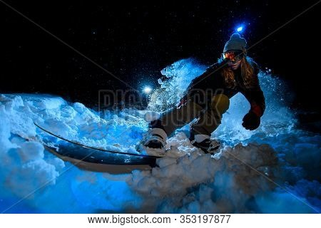 Girl Freerider Doing Stunts On Blue Light Background