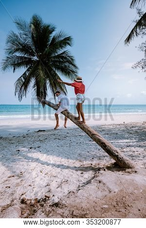 Couple Climbing In Palm Tree In Thailand, Wua Laen Beach Chumphon Area Thailand, Palm Tree Hanging O