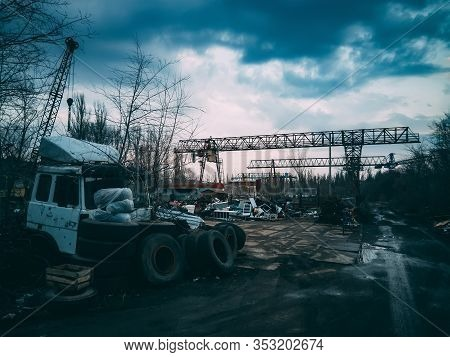 Old Rusty Truck And Garbage In Abandoned Industrial Area