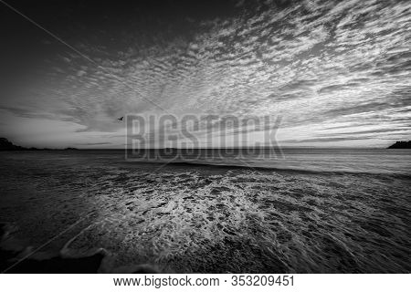 Opposing Patterns Of Clouds In Sky And Backwash Of Waves On Sand At Mount Maunganui Main Beach, Taur