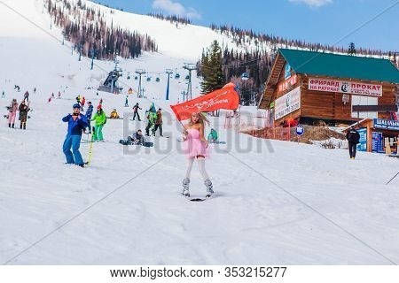 Sheregesh, Kemerovo Region, Russia - April 12, 2019: Young Happy Pretty Woman In Pink On Snow Slope
